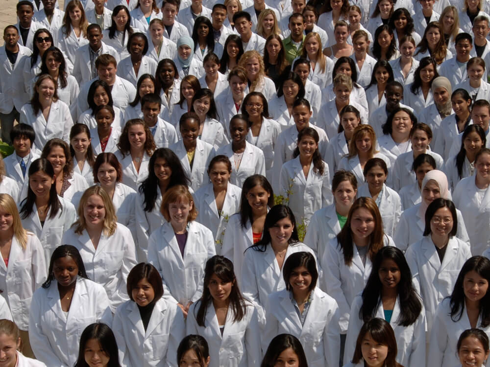 Diverse group of students in whitecoats
