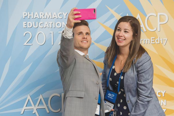 Members strike a pose in front of #PharmEd17's #HealthyStartsHere photo station. Selfietakers were asked to share their patient stories along with their photos from the booth.