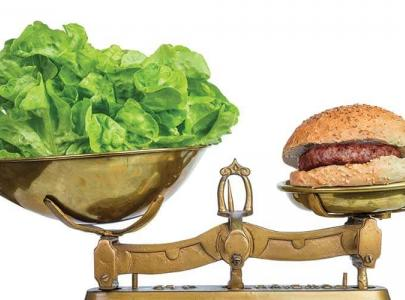 Lettuce weighed against hamburger.